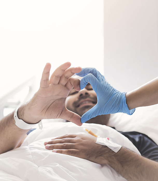 Doctor and patient with hands/heart sign