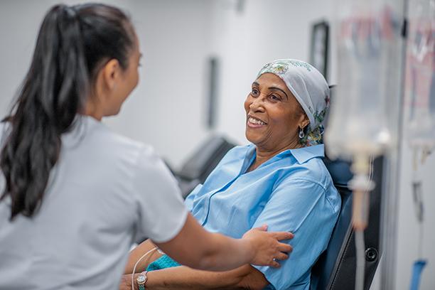 nurse comforting cancer patient